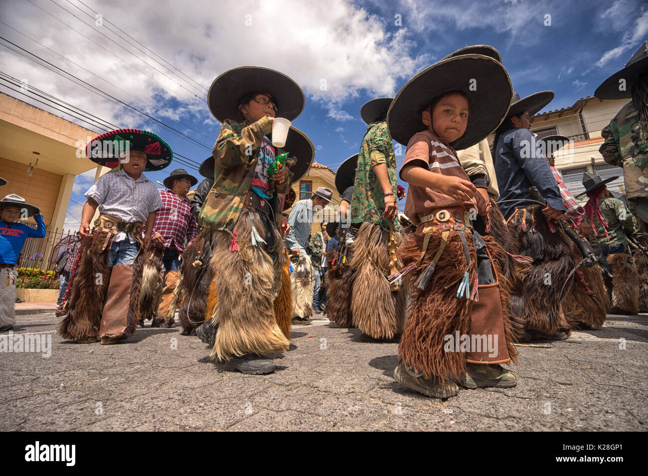 June 25, 2017 Cotacachi, Ecuador: all ages are represented at the Inti Raymi parade in the indigenous kichwa town - Stock Image
