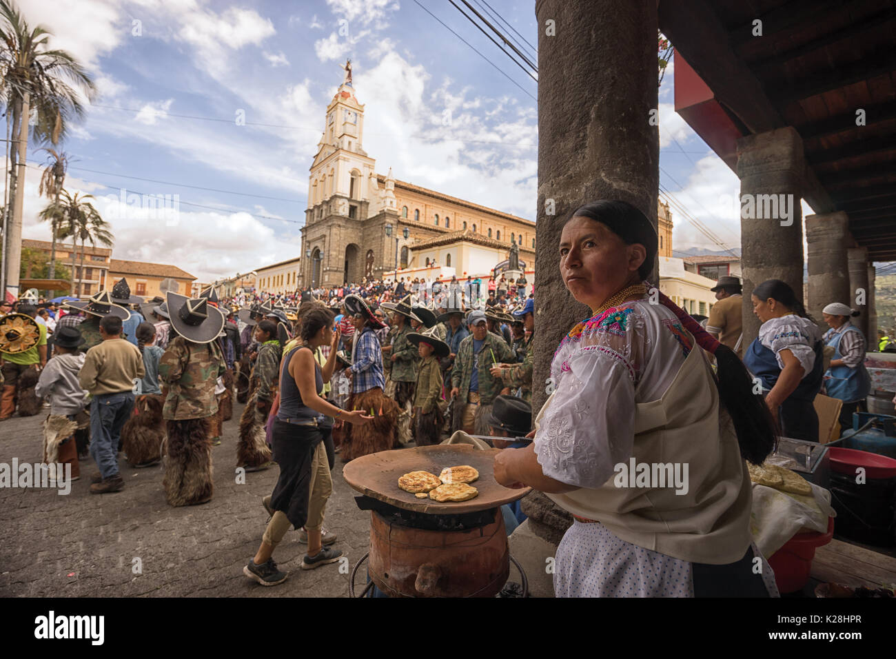 June 25, 2017 Cotacachi, Ecuador: vendors on the side of the main plaza offering traditional food for the parade participants at Inti Raymi - Stock Image