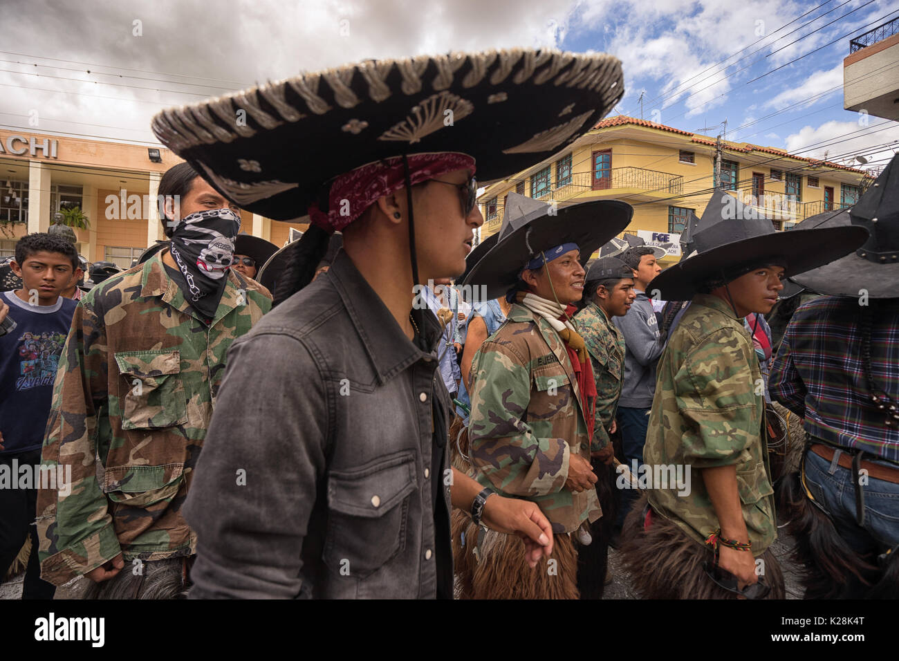 June 25, 2017 Cotacachi, Ecuador: the costumes worn during Inti Raymi by the indigenous people are a sign of revolt against the colonization - Stock Image