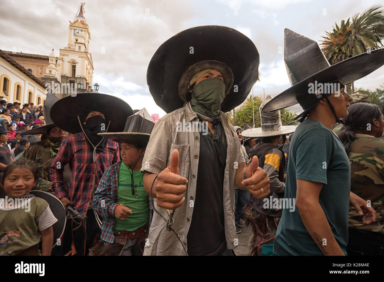 June 25, 2017 Cotacachi, Ecuador: a male dancer shows two thumbs up during Inti Raymi parade - Stock Image