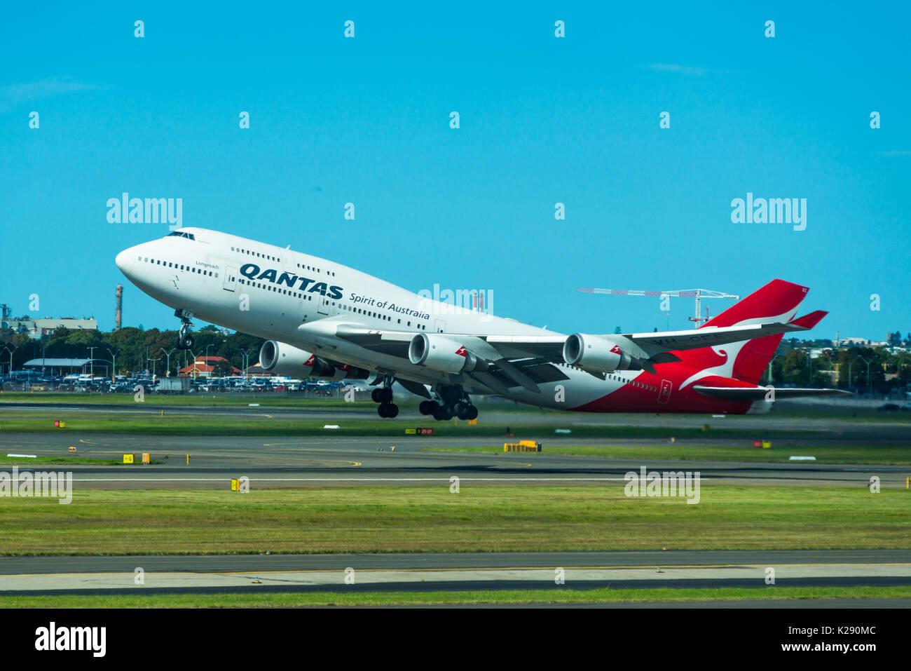 Qantas 747 jumbo jet taking off at Sydney International Airport, New South Wales, Australia. - Stock Image