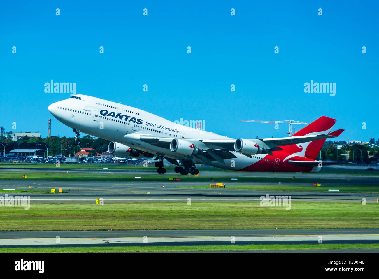 Qantas 747 jumbo jet taking off at Sydney International Airport, New South Wales, Australia. - Stock Image