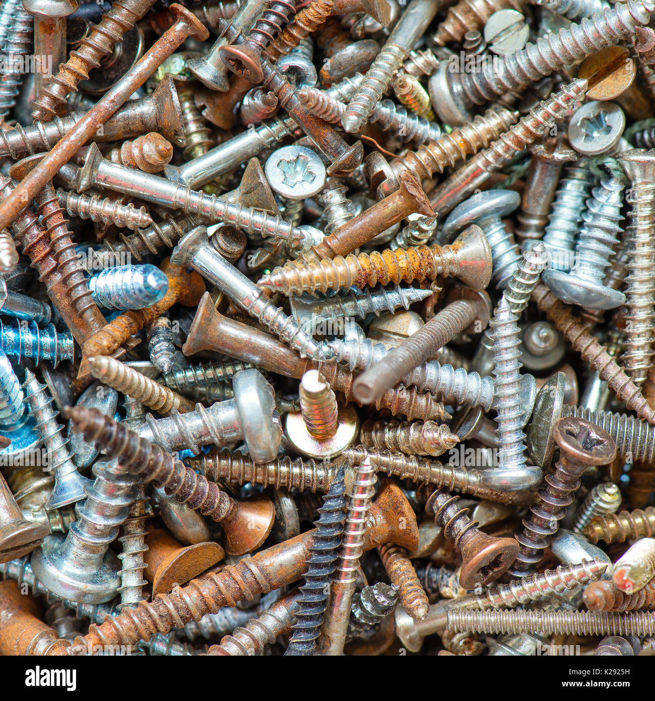 Various screws used and rusty on close-up Stock Photo