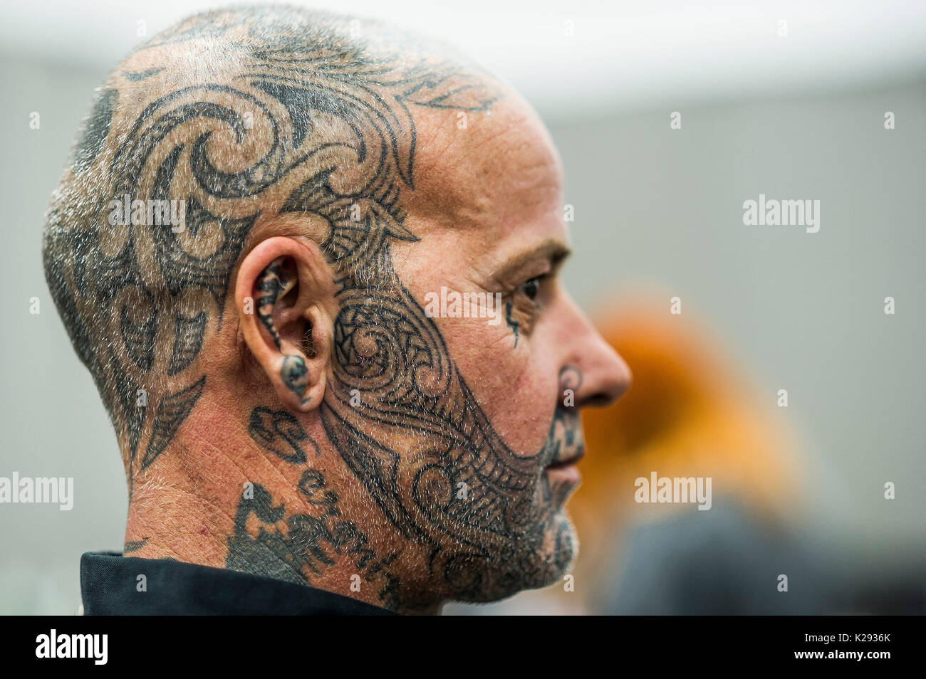 Tattooing. A man with a tattooed face and head at the Cornwall Tattoo Convention. - Stock Image