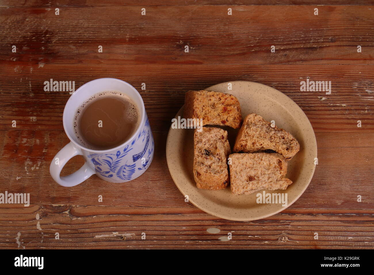 Rusks and coffee - a traditional Afrikaner and South African breakfast meal or snack in landscape format on a clear background with copy space - Stock Image