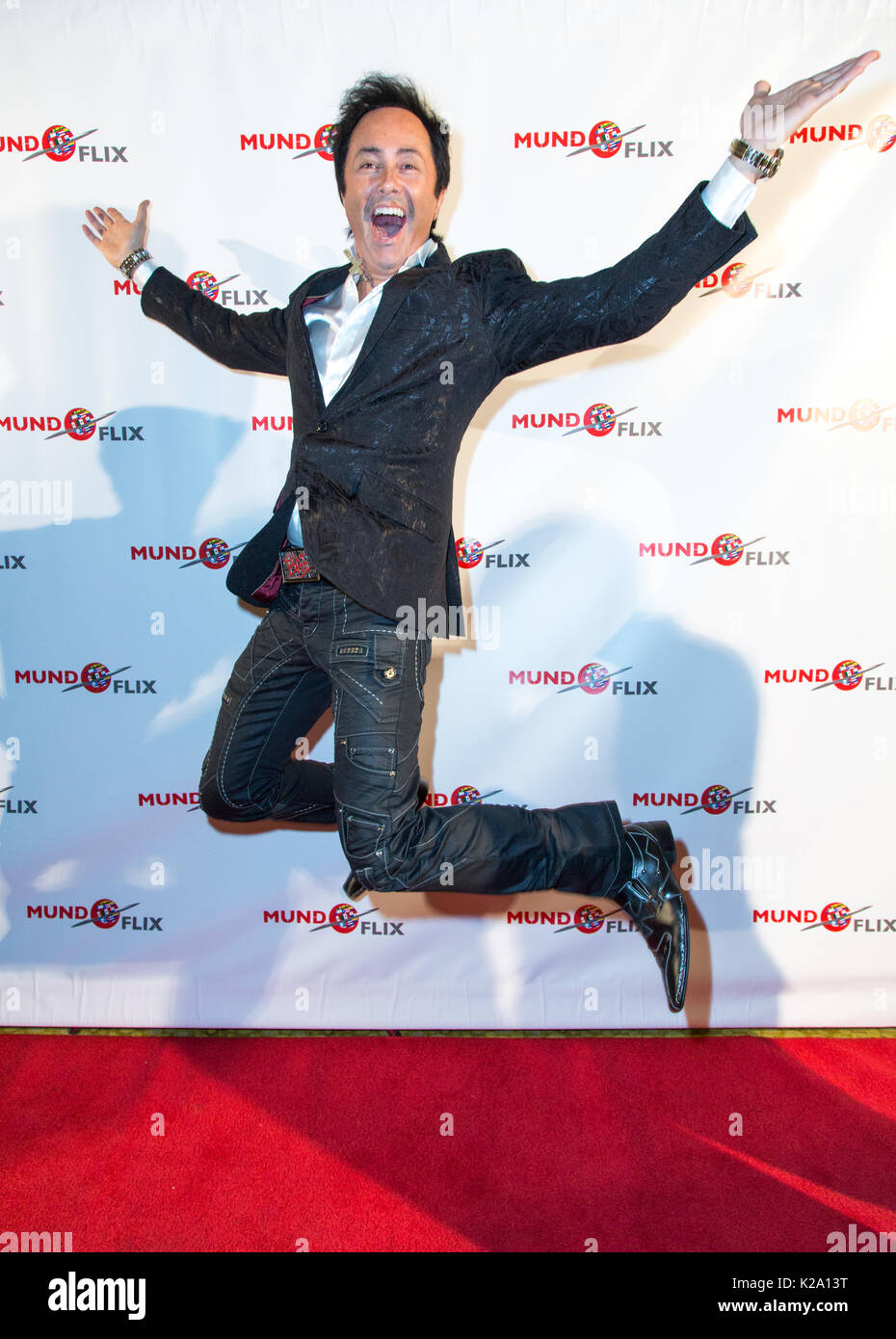 Studio City, California, USA. 28th August, 2017. TV personality Jaime Monroy jumps for joy on the red carpet at the MUNDOFLIX Launch Party at the Sportsmen's Lodge in Studio City, California on August 28, 2017.  MUNDOFLIX is a new media company dedicated to serving the Latino and Hispanic community with film and television content in both Spanish and English.  Credit: Sheri Determan/Alamy Live News - Stock Image