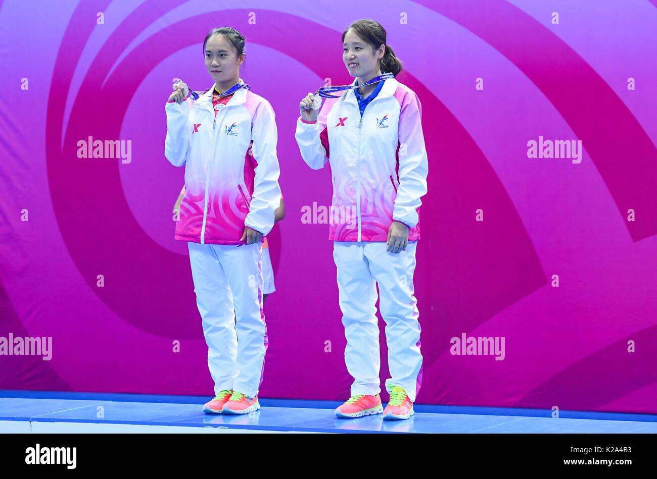 Zhu Xueying (L) of Tianjin poses with