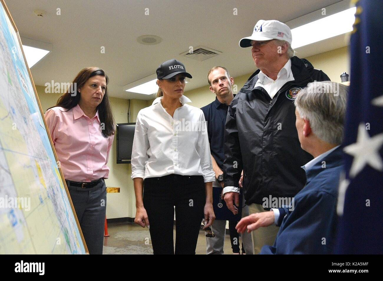 U.S. President Donald Trump is briefed by Texas Governor Greg Abbott, right, on the damage from Hurricane Harvey at Fire Station 5 August 29, 2017 in Corpus Christi, Texas. Standing from left to right are: Acting DHS Secretary Elaine Duke, First Lady Melania Trump, FEMA Administrator Brock Long, President Donald Trump and Texas Governor Greg Abbott. - Stock Image