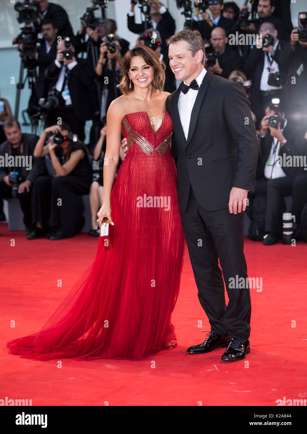 Venice, Italy. 30th Aug, 2017. Actor Matt Damon and his wife Luciana Barroso arrive on the red carpet of the premiere of the film 'Downsizing' which opens the 74th edition of the Venice Film Festival in Venice, Italy, on Aug. 30, 2017. The 74th edition of the Venice Film Festival lasts from Aug. 30 to Sept. 9. Credit: Jin Yu/Xinhua/Alamy Live News - Stock Image