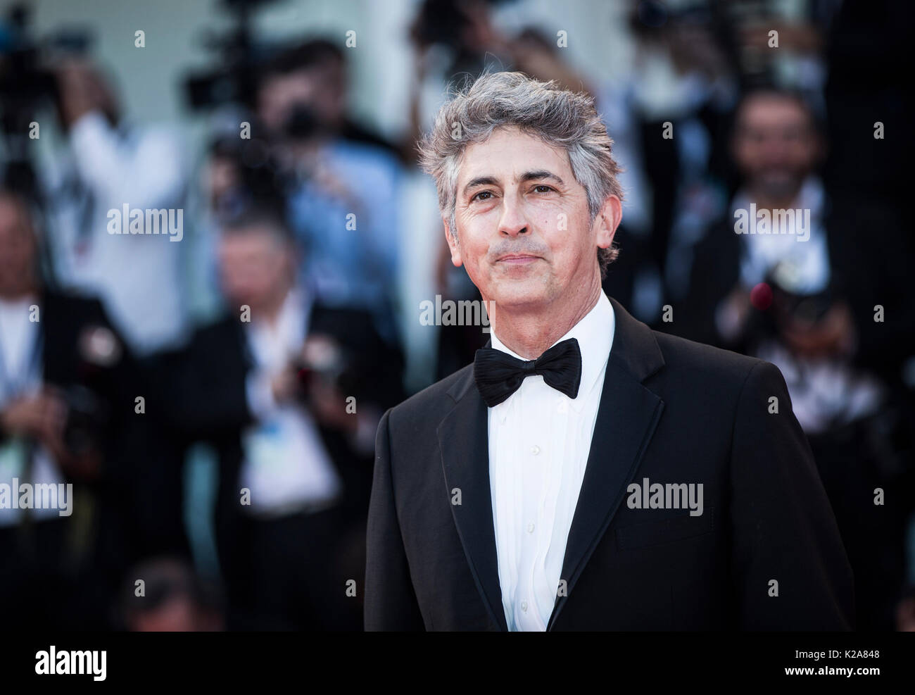 Venice, Italy. 30th Aug, 2017. Director Alexander Payne arrives on the red carpet of the premiere of the film 'Downsizing' which opens the 74th edition of the Venice Film Festival in Venice, Italy, on Aug. 30, 2017. The 74th edition of the Venice Film Festival lasts from Aug. 30 to Sept. 9. Credit: Jin Yu/Xinhua/Alamy Live News - Stock Image