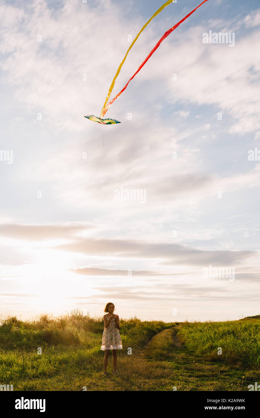 Girl with kite on nature - Stock Image