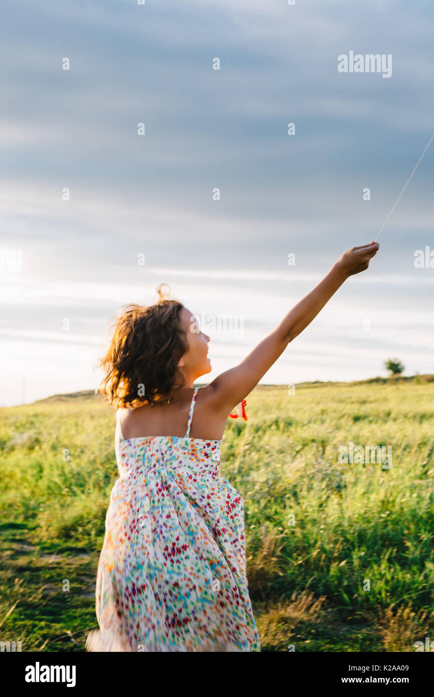 Anonymous girl with kite - Stock Image