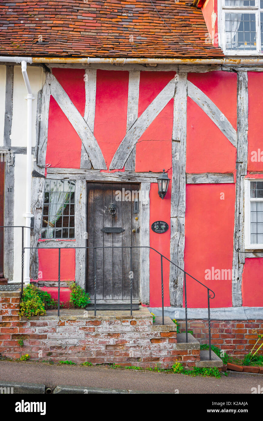 Lavenham Suffolk colour, exterior detail of the front of a medieval half timbered pink house in the Suffolk village of Lavenham, England. - Stock Image