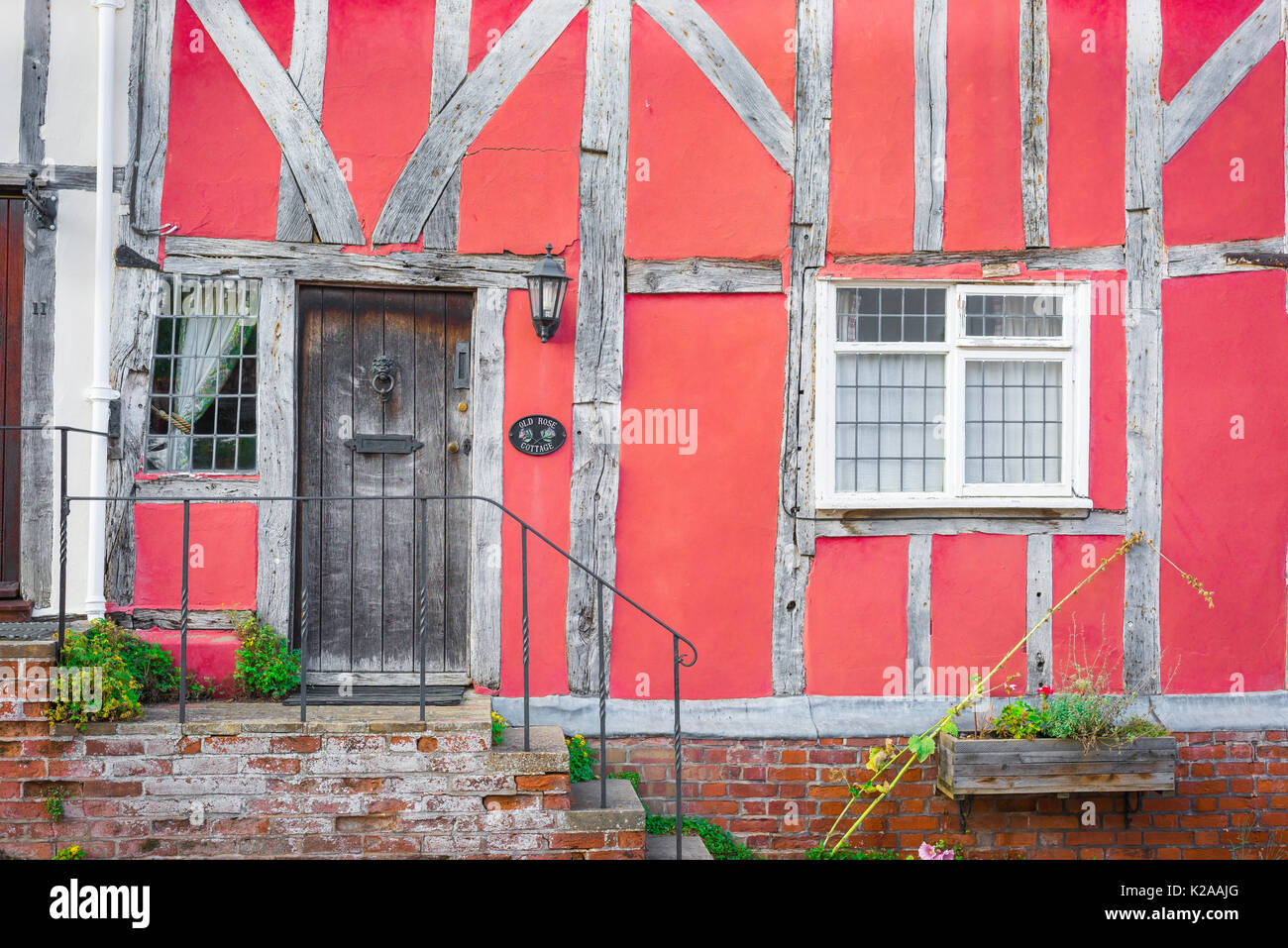 Lavenham Suffolk building, exterior detail of a medieval half timbered pink house in the Suffolk village of Lavenham, England, UK - Stock Image