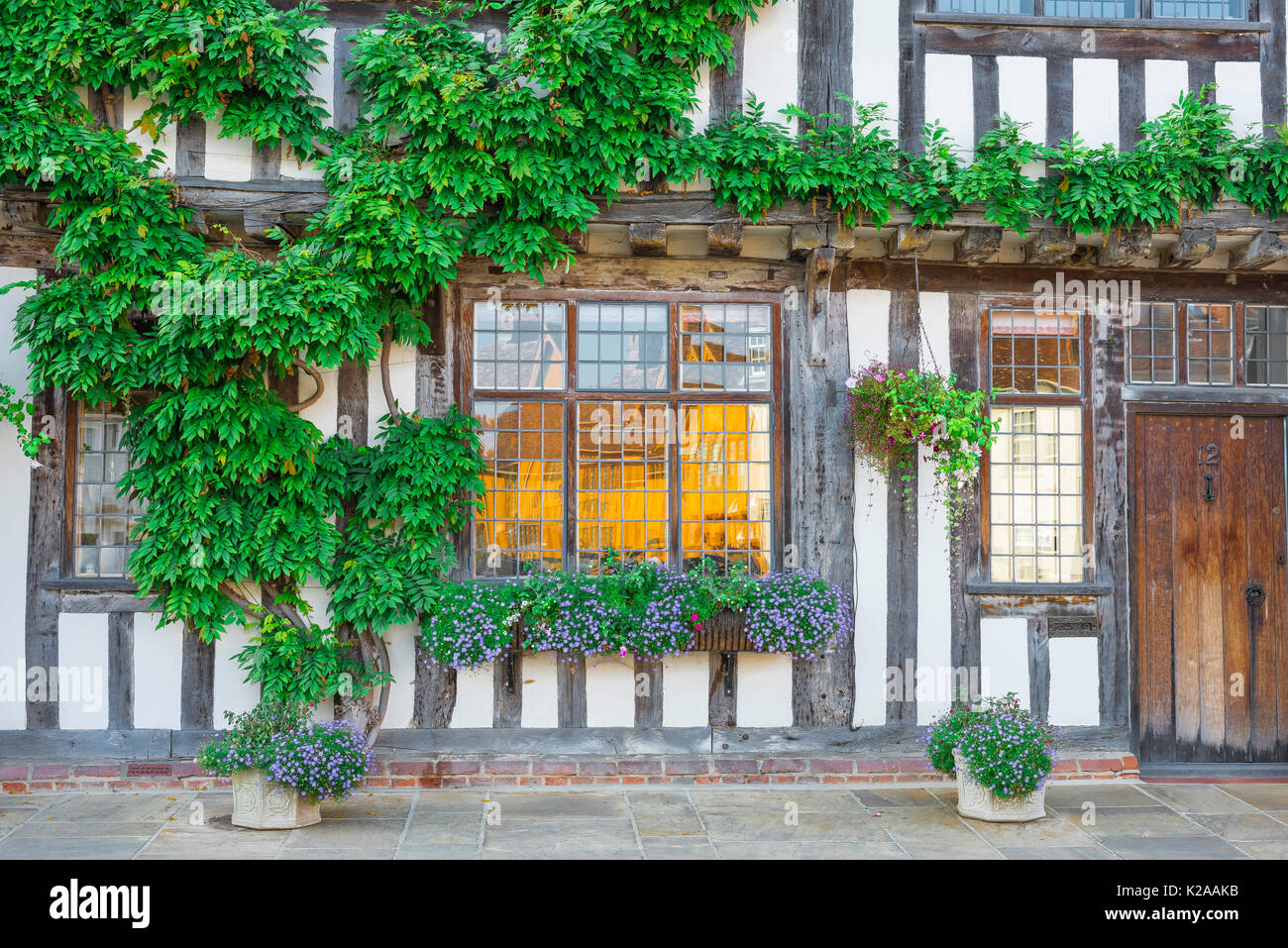 Lavenham Suffolk house colour, exterior detail of a medieval half timbered building sited in Market Square Lavenham, Suffolk, England. - Stock Image