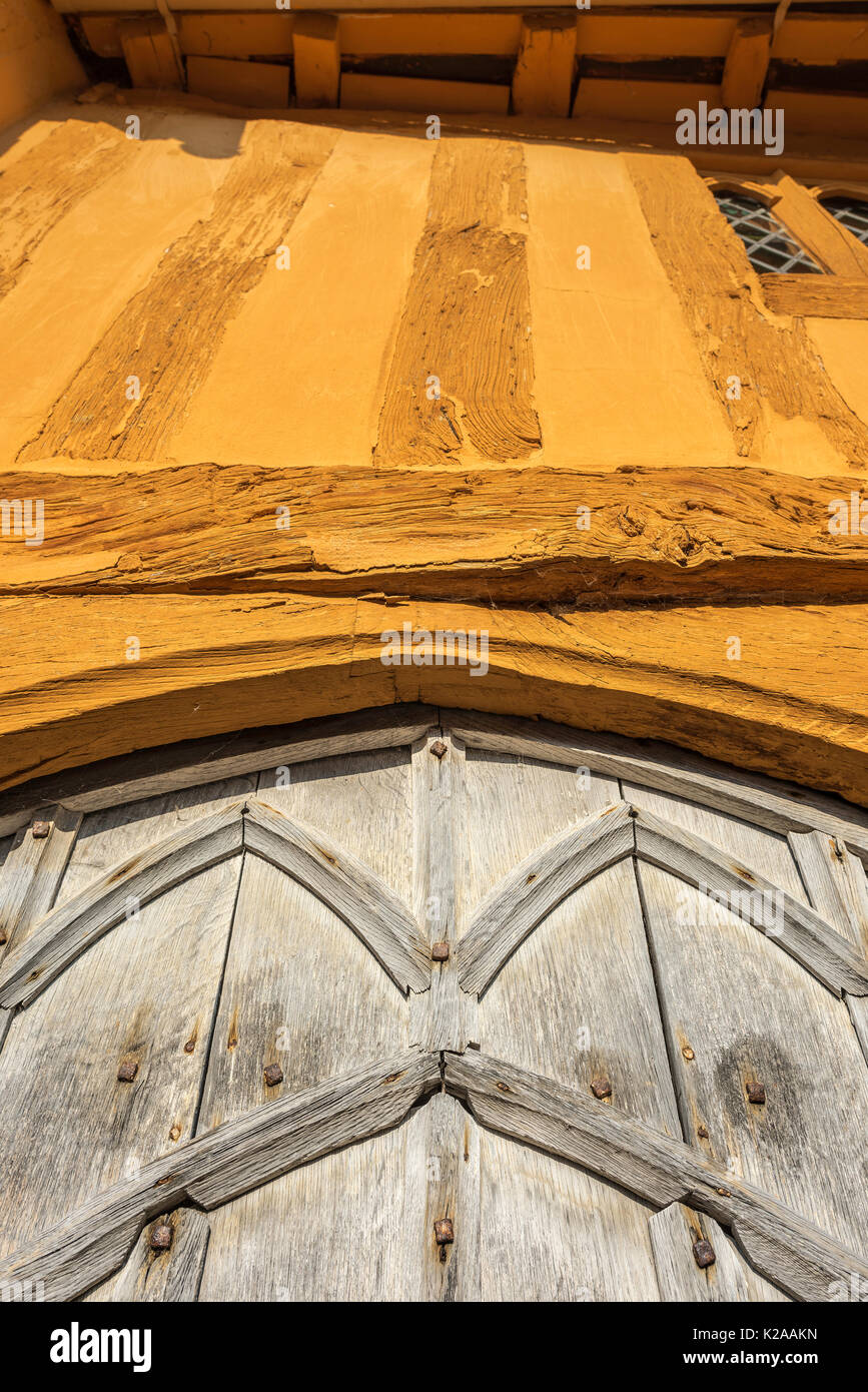 Medieval building, detail of the gothic oak door and timbers of Little Hall, a medieval oak half timbered hall house in Lavenham, Suffolk, England, UK - Stock Image
