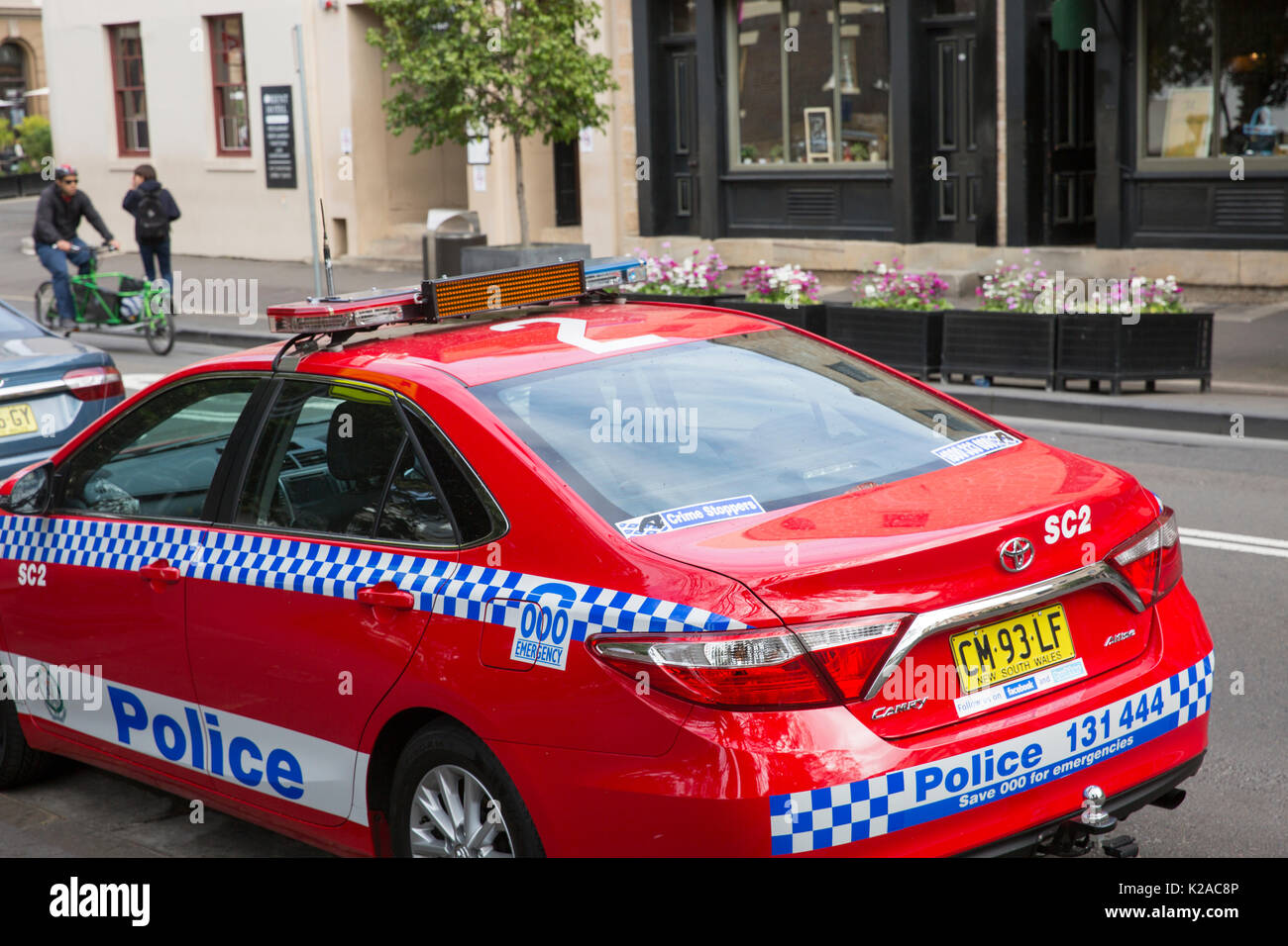 New South Wales police red vehicle police car parked in Sydney,Australia - Stock Image