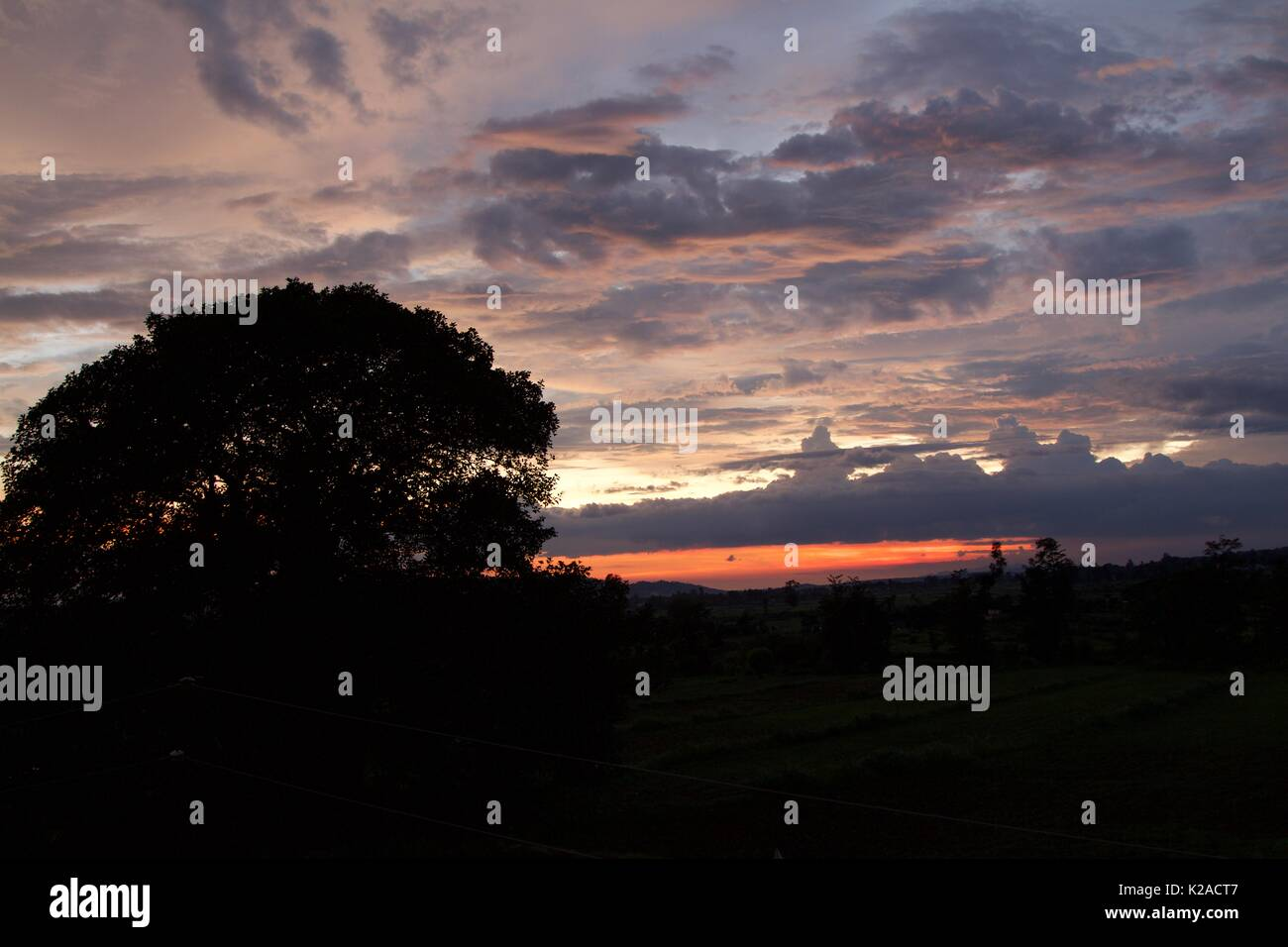 beautiful images captured of amber coloured evening sky with sunset and clouds Stock Photo