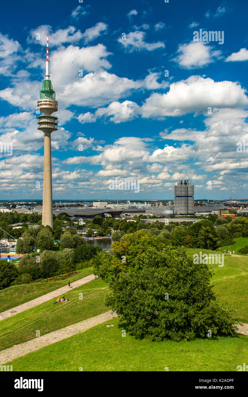 Olympic Tower and BMW Tower in the background, Olympiapark, Munich, Bavaria, Germany - Stock Image