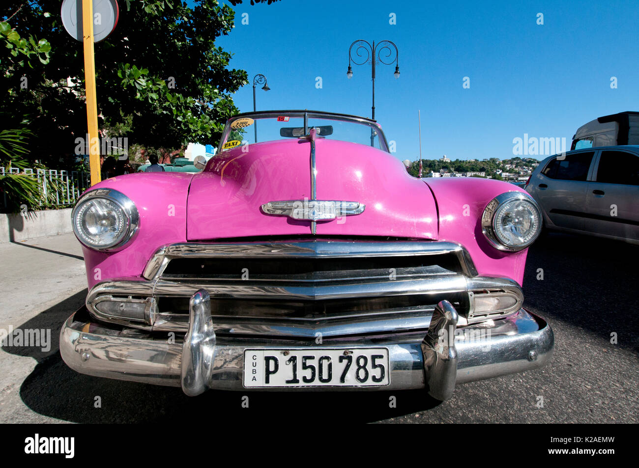 Pink 1953 Chevy convertible taxi parked in Old Havana Cuba - Stock Image