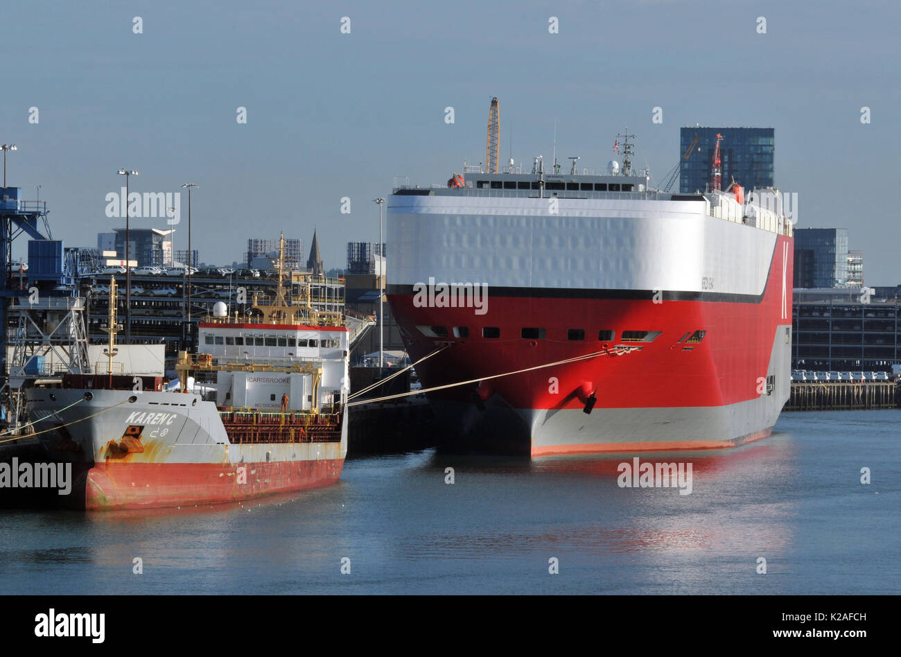 Large car carrying ships at southampton docks carries of vehicles loading and unloading ports exports and imports. - Stock Image