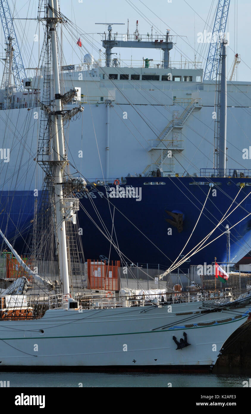 a modern car carrying ship transpoters and an old sailing ship or vessel together alongside at Southampton docks uk port contrast between new and old - Stock Image