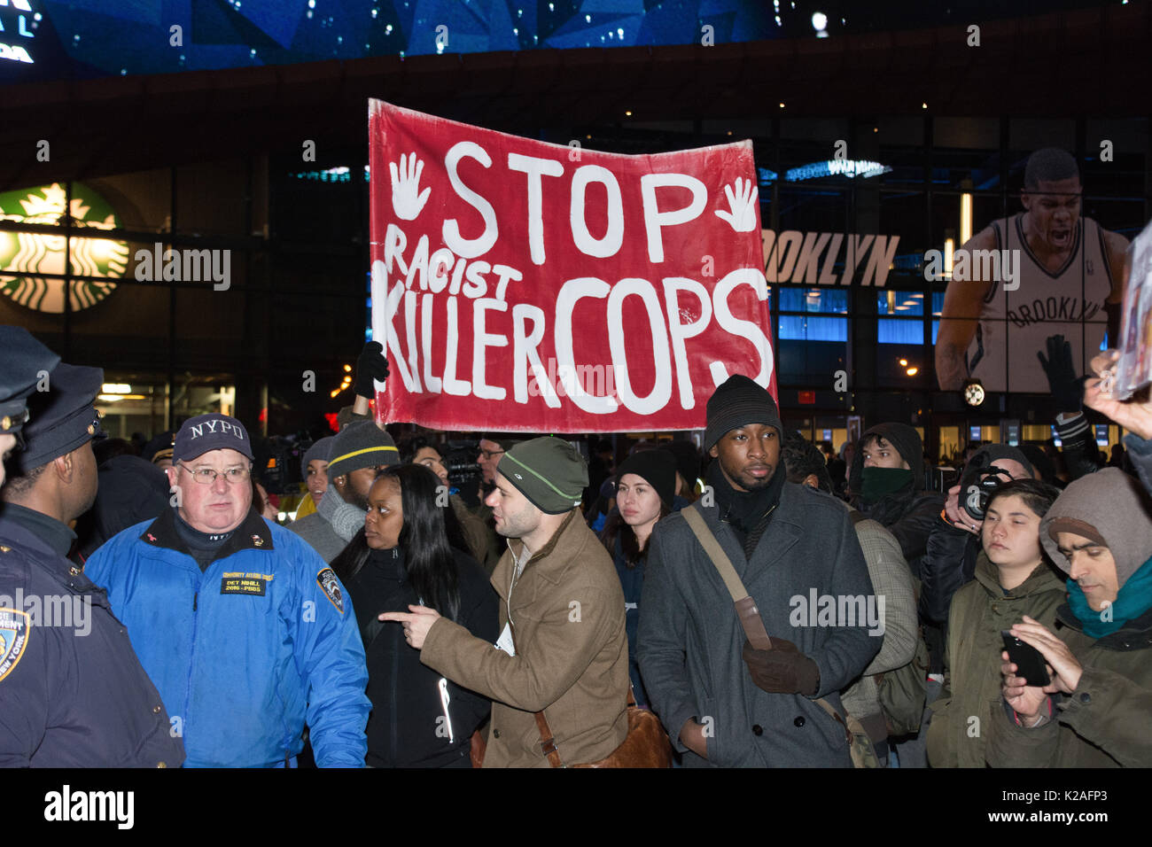 Black Lives Matter activists protested at Barclays Center after a grand jury failed to indict officer in Eric Garner case. - Stock Image