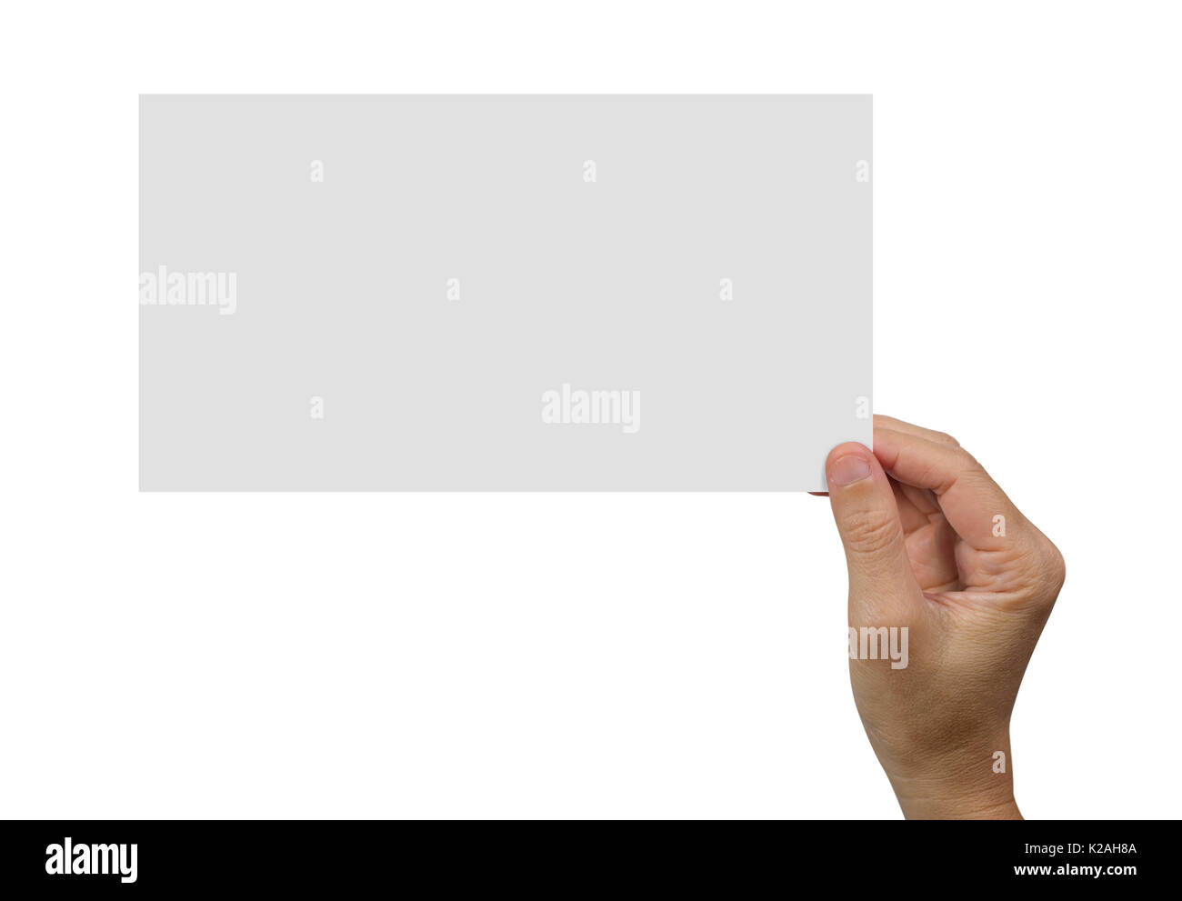 Hands holding a white blank poster for advertising on an isolated white background, concept and idea for business. - Stock Image