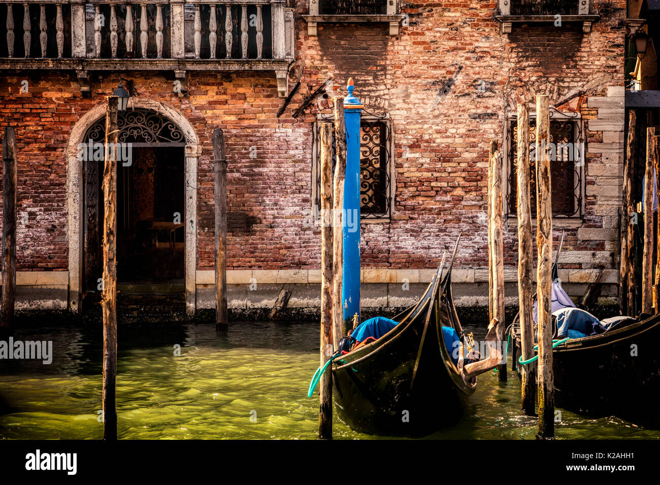 Weathered building facade in Venice, Italy - Stock Image