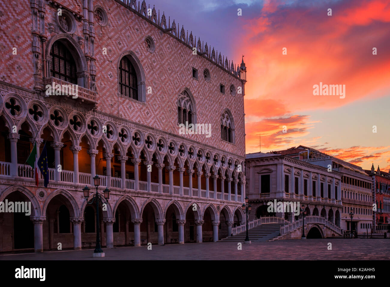 Dramatic clouds at sunrise over the Doges Palace In Venice, Italy - Stock Image