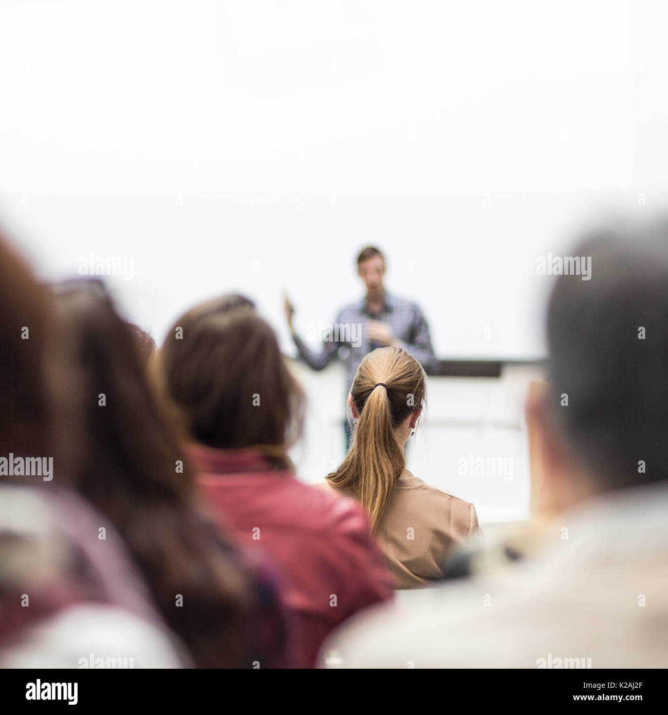 Public speaker giving talk at Business Event. - Stock Image