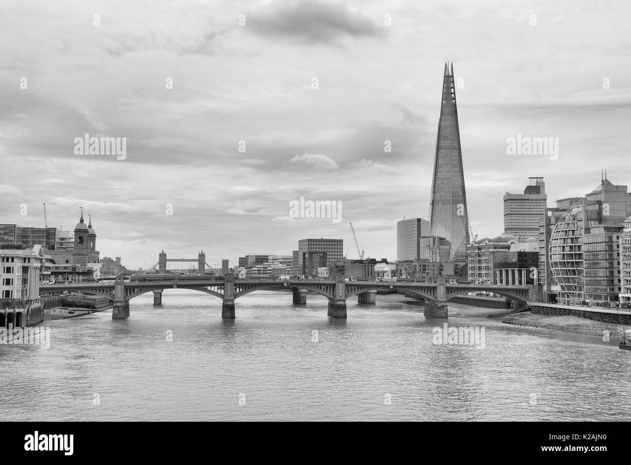 London skyline and the River Thames including Southwark Bridge and The Shard building - Stock Image
