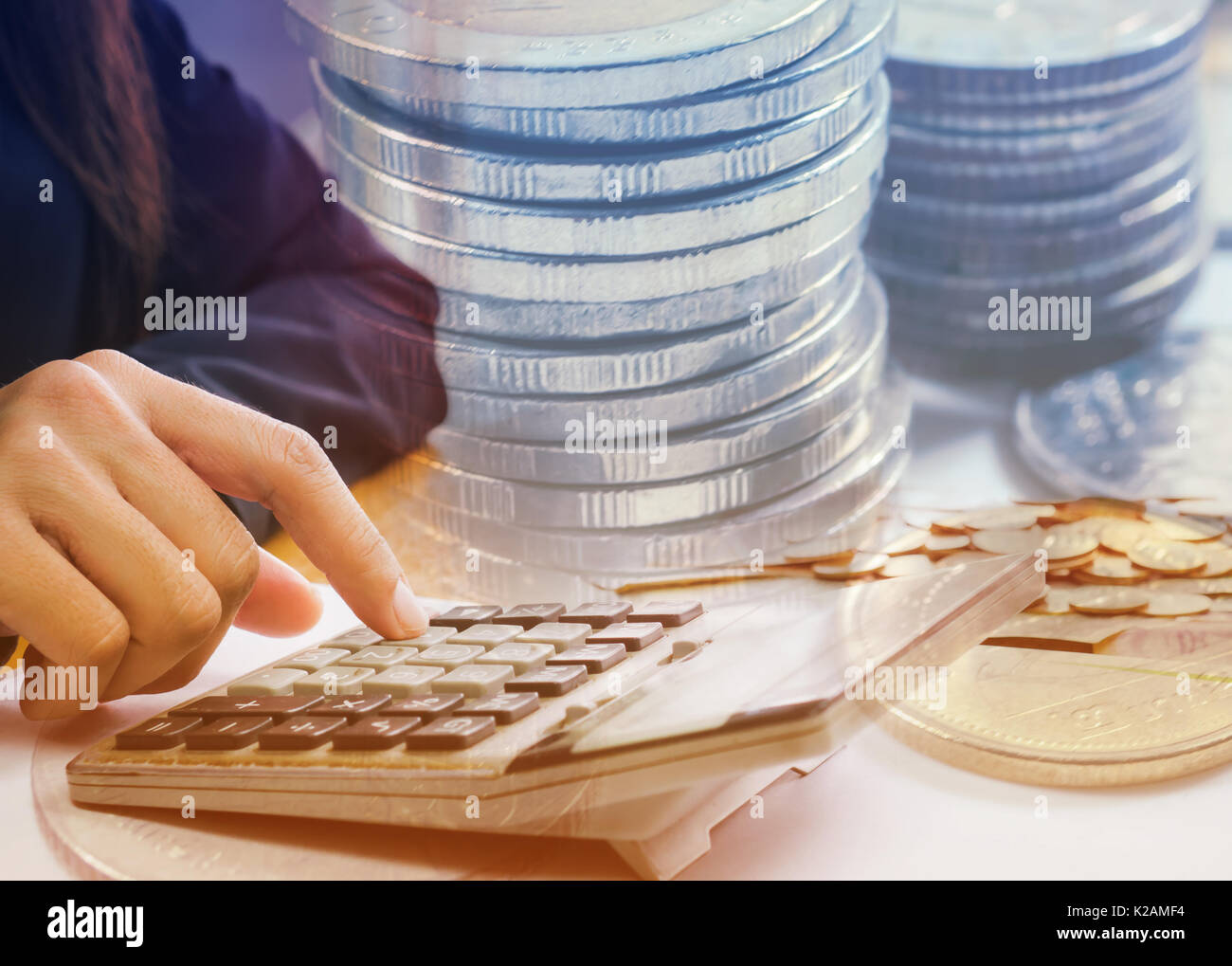 Double exposure female accountant making calculations. Savings, finances and economy concept Stock Photo