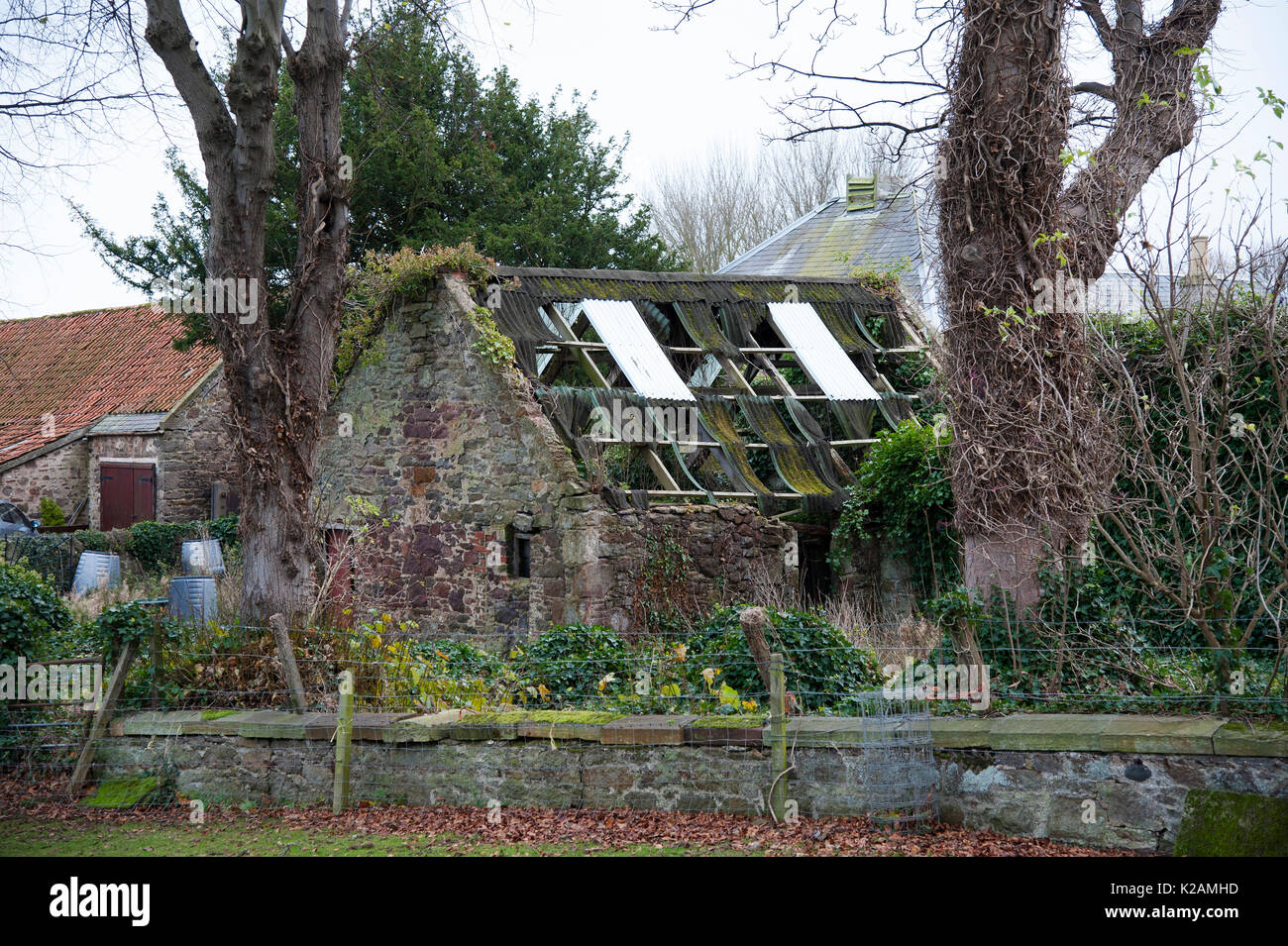 Ruined building being taken back by nature. - Stock Image