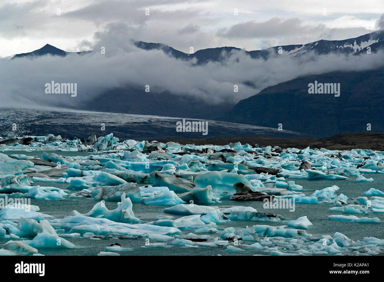 Floating icebergs in the glacial lake Jokulsarlon - Iceland - Stock Image