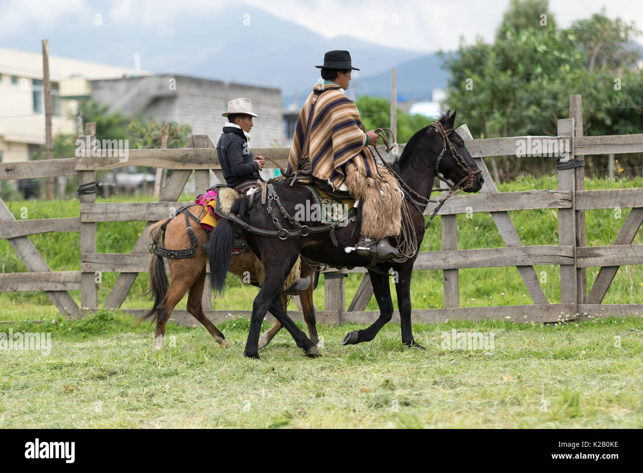 June 3, 2017 Machachi, Ecuador: cowboys called riding heir horses in the morning in the high altitude town - Stock Image