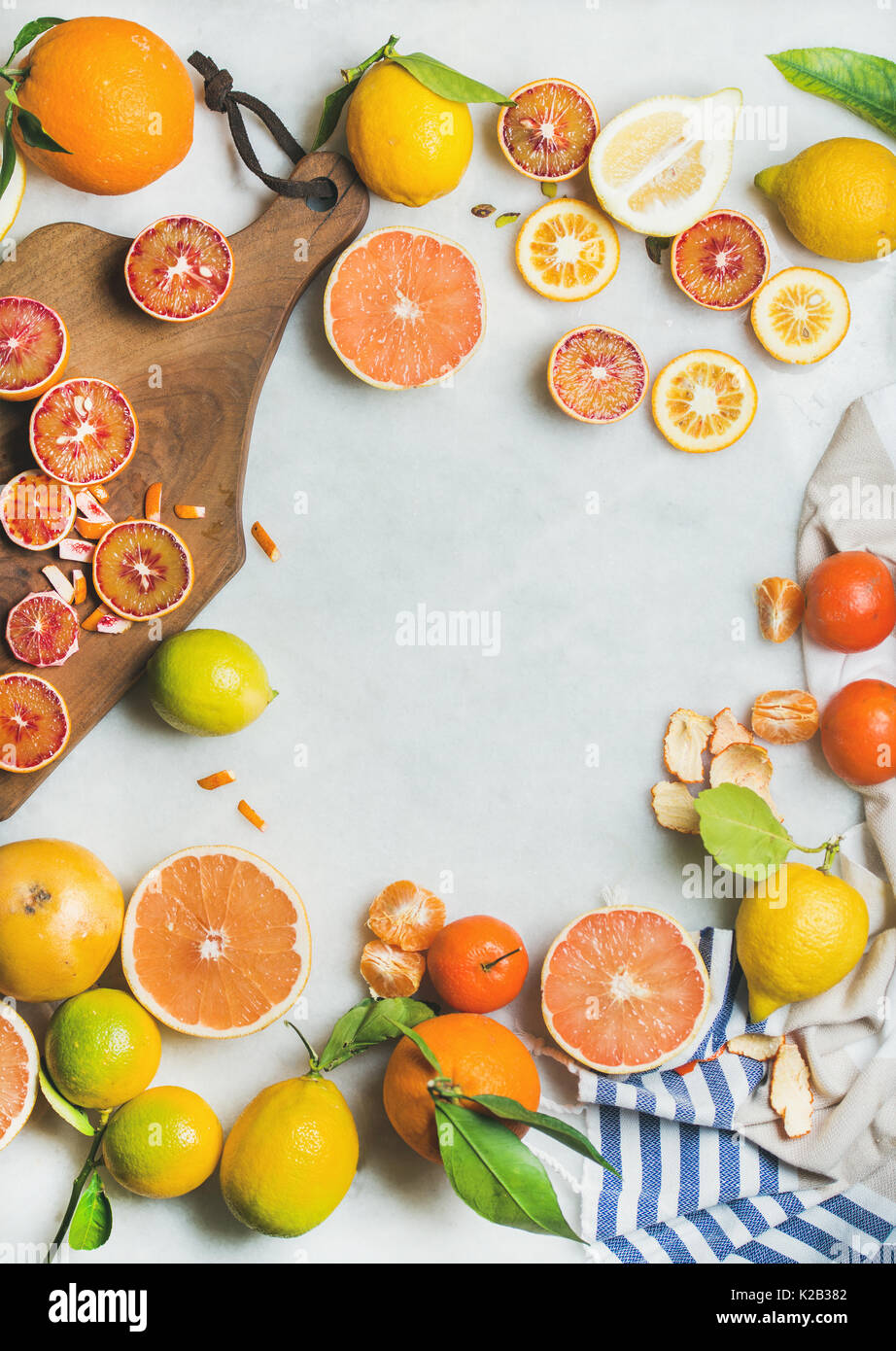 Natural fresh citrus fruits over grey marble table background Stock Photo