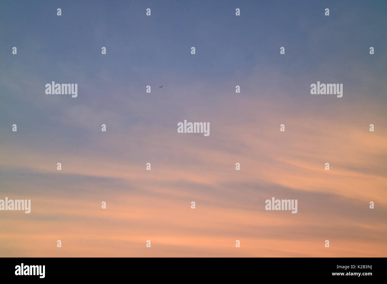 Pastel Orange and Blue Tropical Sunset Sky with the Airplane, Bangkok, Thailand - Stock Image