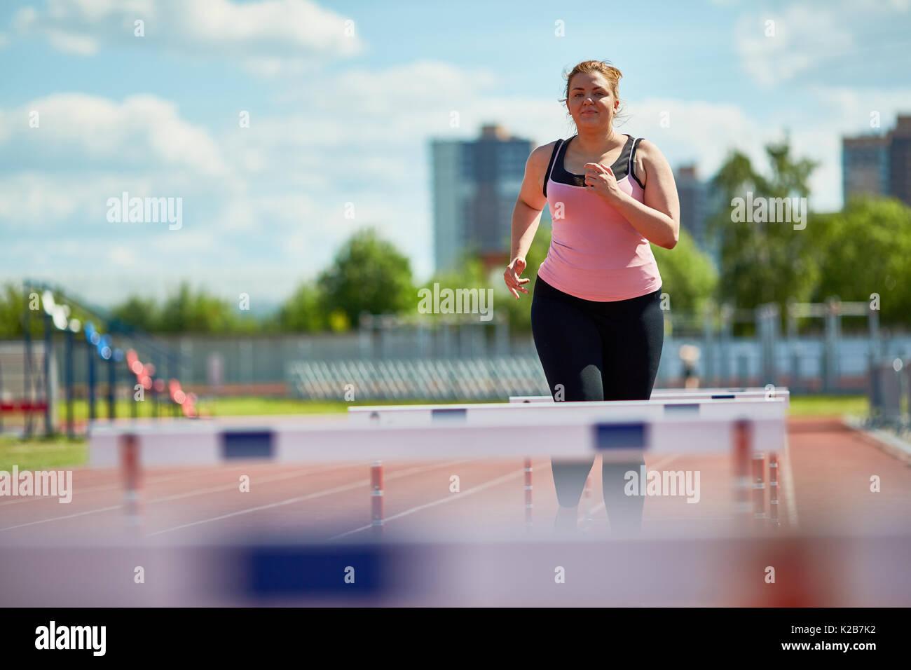 Hurdle running - Stock Image