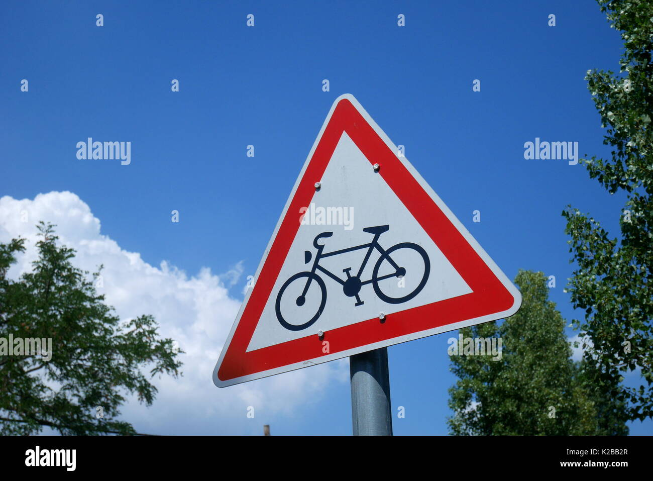 Triangular sign warning of a cycle route ahead, Margaret Island, Budapest, Hungary Stock Photo