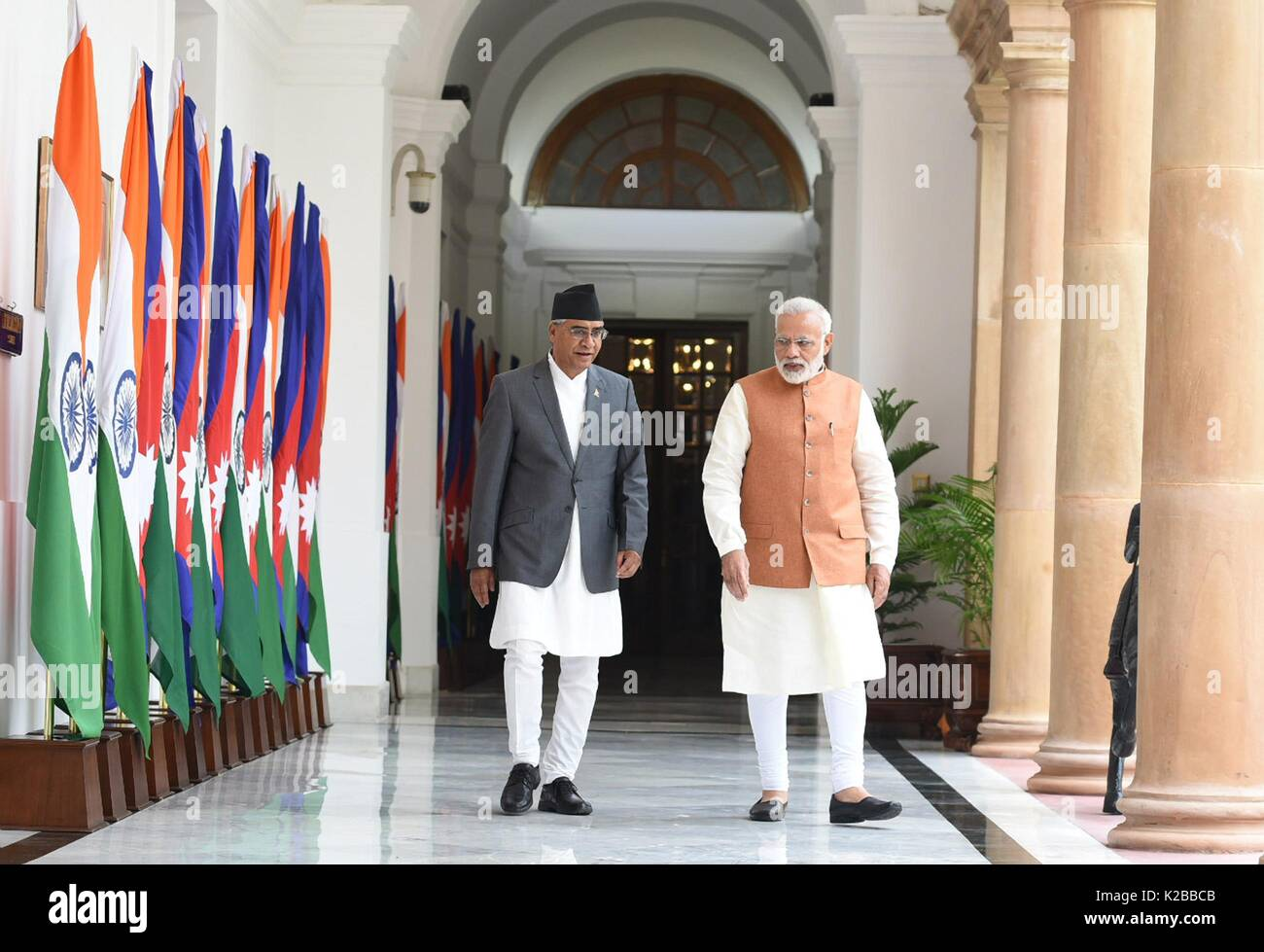 Indian Prime Minister Narendra Modi escorts Nepalese Prime Minister Bahadur  Deuba, left, at Hyderabad House August 24, 2017 in New Delhi, India.
