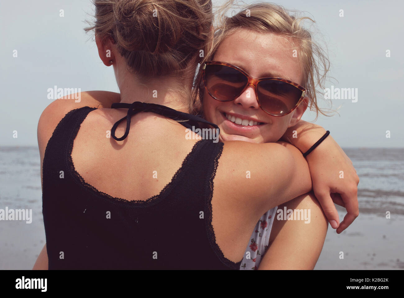 Two friends hugging - Stock Image