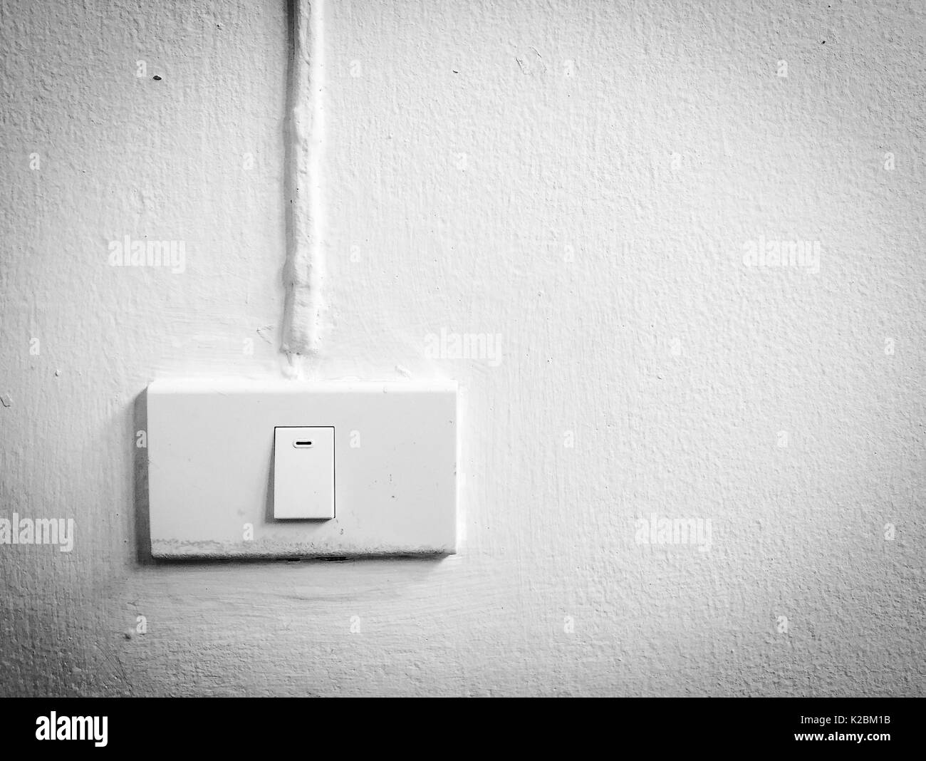White electric switch on wall - Stock Image