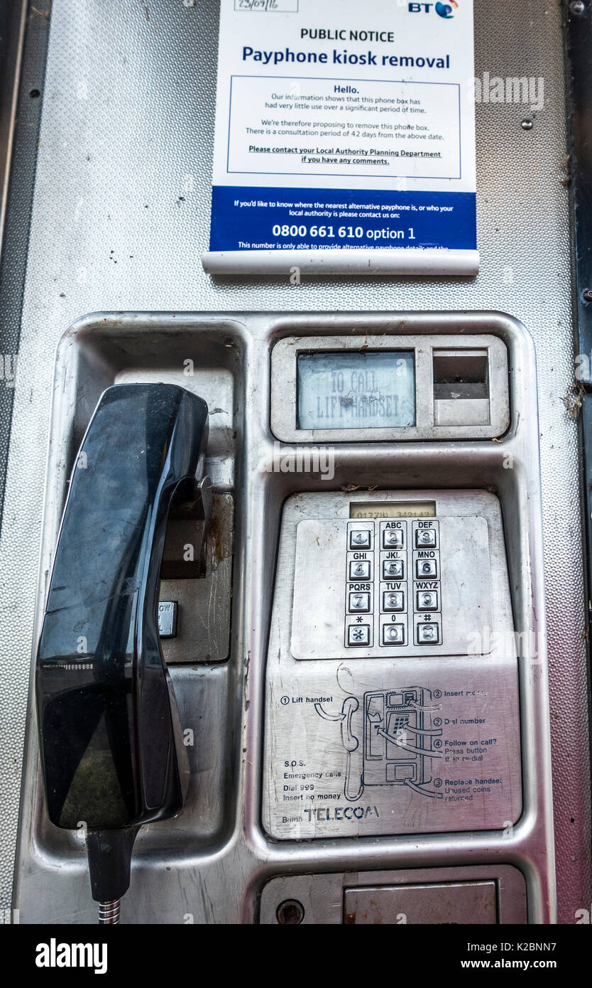 BT notice in a telephone box, stating the kiosk is to be removed after a consultation period due to lack of use. Langtoft, Lincolnshire, England, UK. - Stock Image