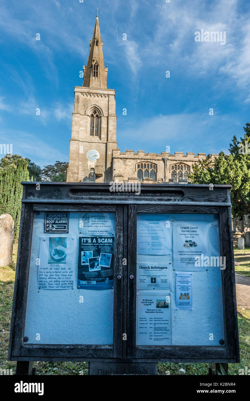 Village notice board outside the ancient and historic church in Langtoft, Lincolnshire, England, UK. - Stock Image