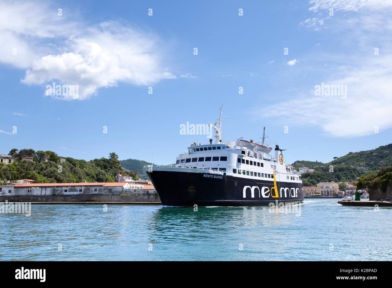 Ferry boat departs Ischia port, Ischia Island, Italy, Tyrrhenian Sea, Mediterranean. June 2009. - Stock Image