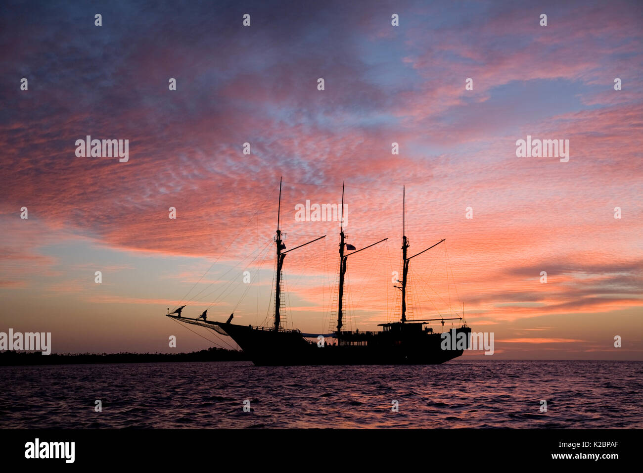 Luxury liveaboard Paradise Dancer at sunset, North Sulawesi, Indonesia, Pacific Ocean. May 2008. - Stock Image