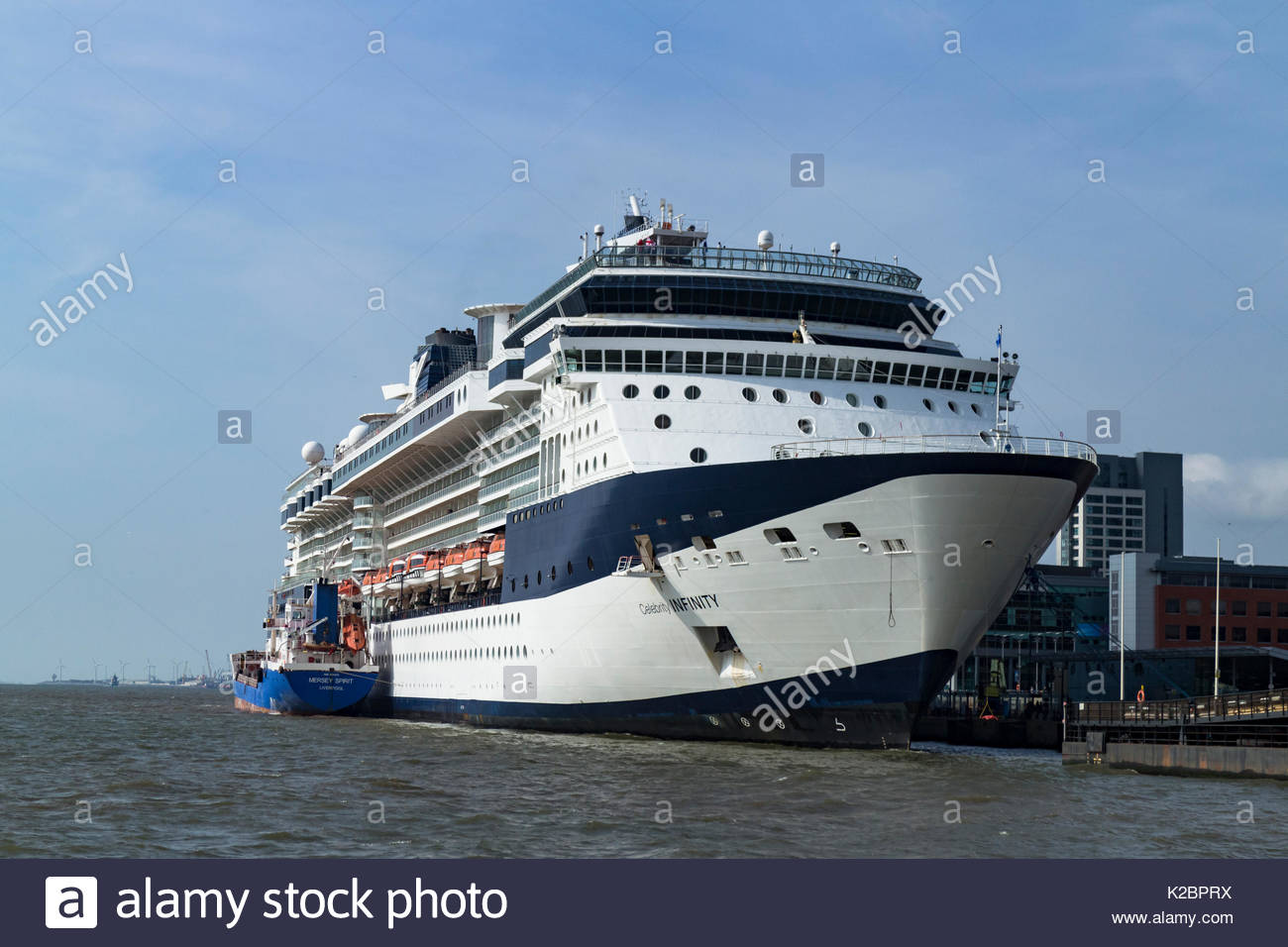 Cruise ship 'Celebrity Infinity' docked at Liverpool cruise liner terminal, with tanker 'Mersey Spirit' alongside, Merseyside, UK, June 2014. All non-editorial uses must be cleared individually. - Stock Image