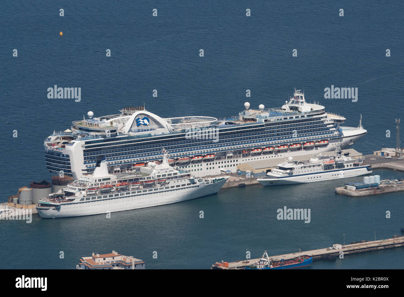 Crown Princess (largest) with Discovery and the Clipper Odyssey (smallest, a 120 passenger vessel) in Gibraltar Harbour, May 2012. All non-editorial uses must be cleared individually. - Stock Image