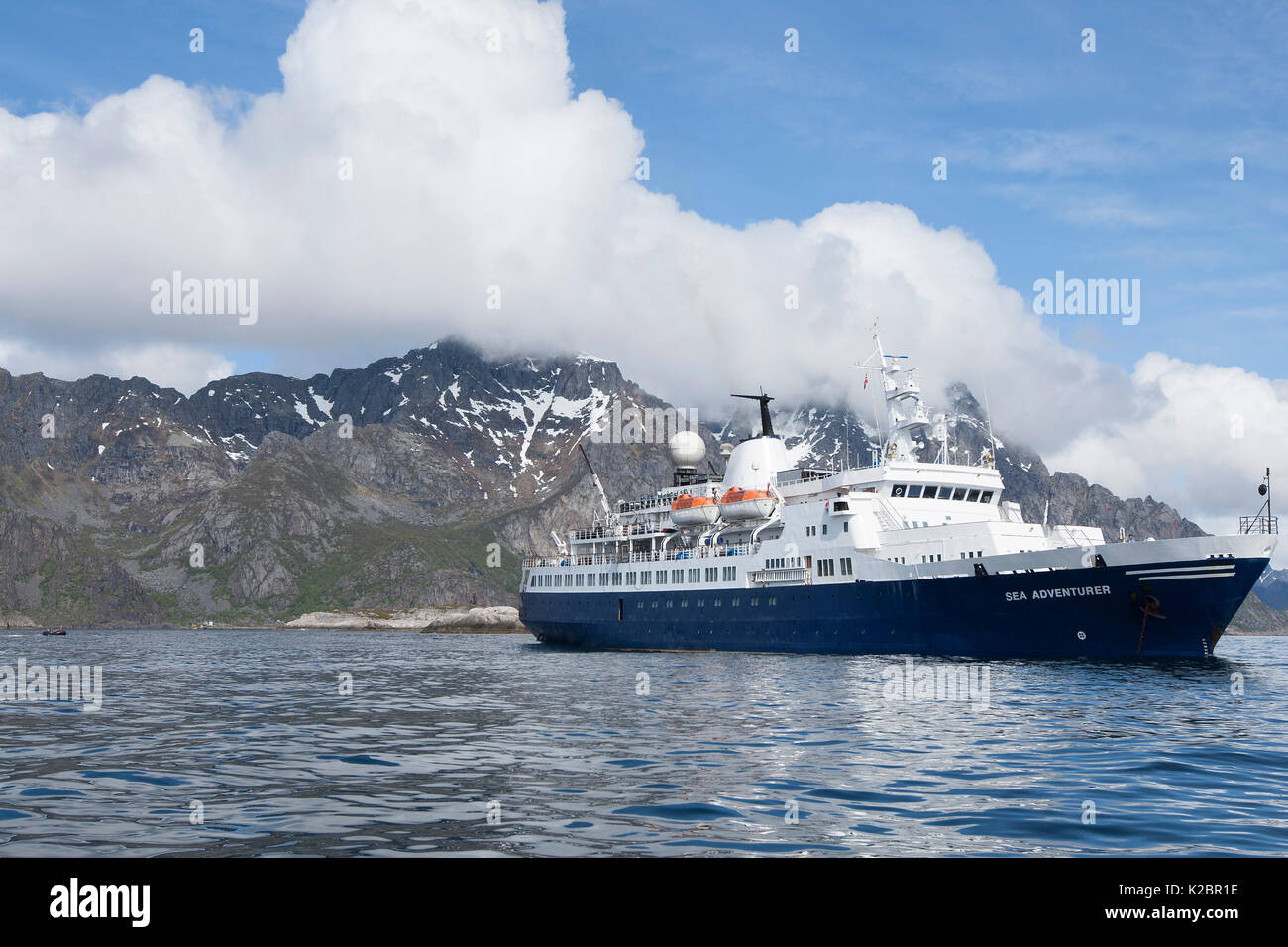 'Sea Adventurer', formerly the 'Clipper Adventurer', at anchor off Henningsvaer, Lofoten Islands, Norway, June 2015. All non-editorial uses must be cleared individually. - Stock Image